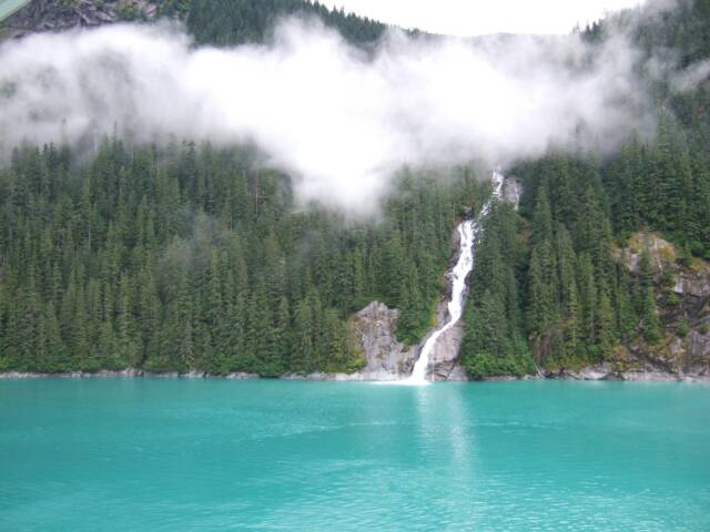 Tracy Arm Fjord waterfall and eagle cloud